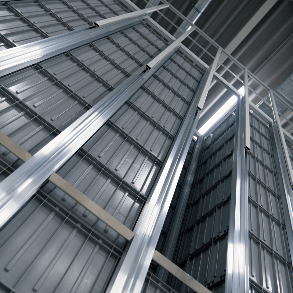 Aluminium grid storing bins above each other